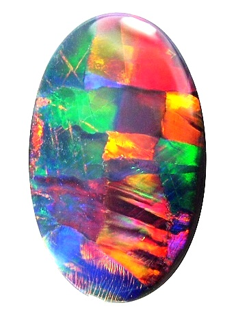 An oval polished opal showing roughly squarish colors of red, yellow, blue, and green.