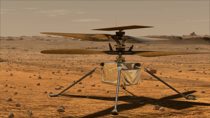 3-legged device with 2 rotors sitting on reddish rocky terrain with dusty sky.