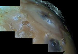 Mottled colored terrain with large plume on the edge, on black background.