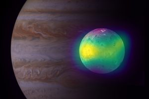 Bright yellowish and bluish moon in front of dimmer giant planet.