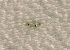 A cluster of small meteor craters on Mars.