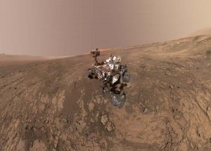 image of curiosity rover exploring surface of Mars