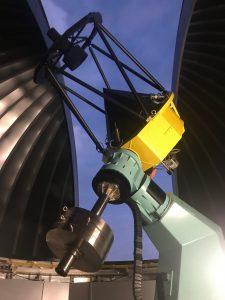 Telescope inside observatory dome.