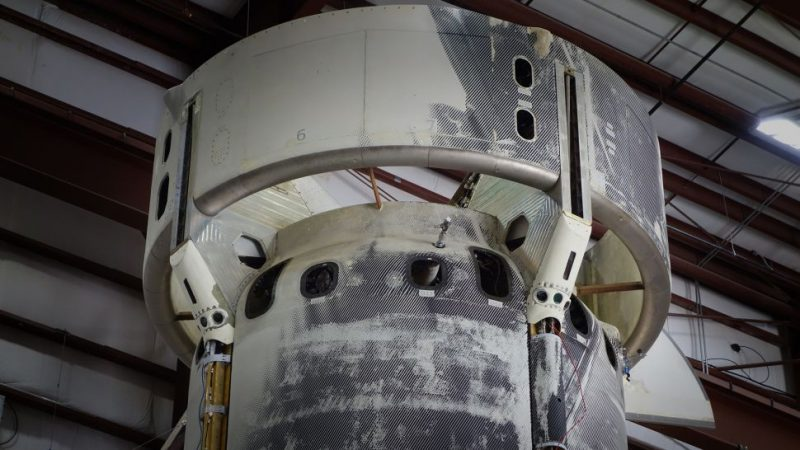 Bottom view of a dusty round rocket engine.