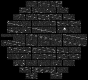 A time-lapse image shows the passage of a Starlink satellite cluster, creating bright streaks through a telescope's field of view.