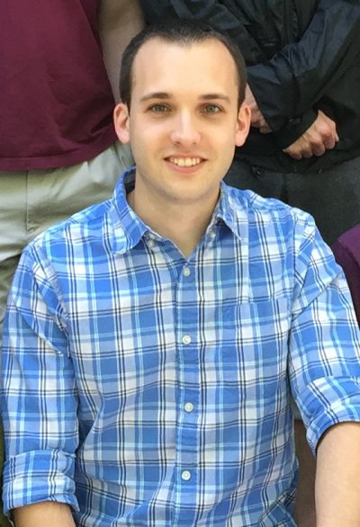 A young man in a blue plaid shirt.