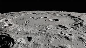 The moon's Clavius crater is seen in this photo, defined by sunlit ridges with dark shadows.