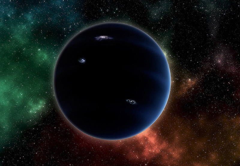 Large dark planet with stars and nebulae in background.