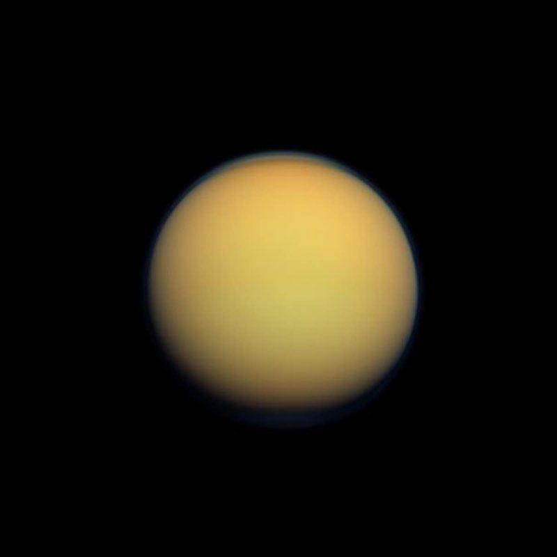 Orange to yellow featureless planet with fuzzy edges.