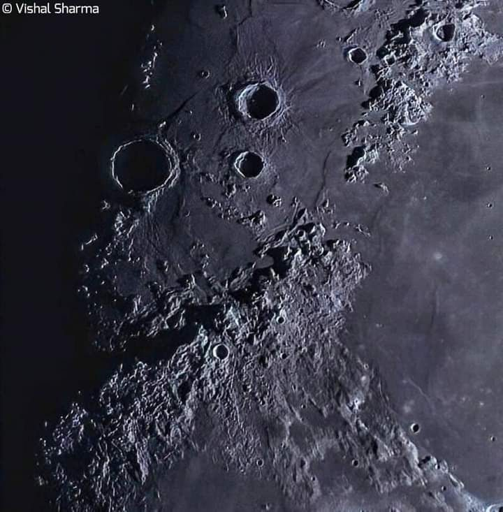 Spiky-looking Montes Apenninus show exaggerated features when the moon's terminator crosses them.