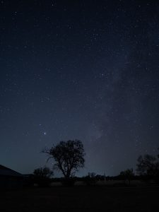 Jupiter and Saturn along with a faint Milky Way over Texas Hill Country.