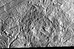 Circular feature on fractured gray terrain.