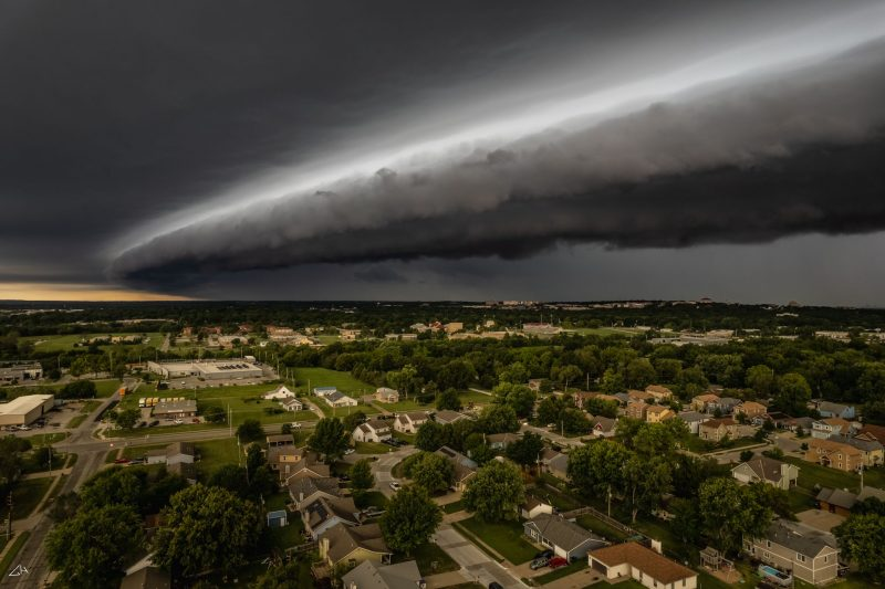 Shelf cloud rolling over city, seen from above.