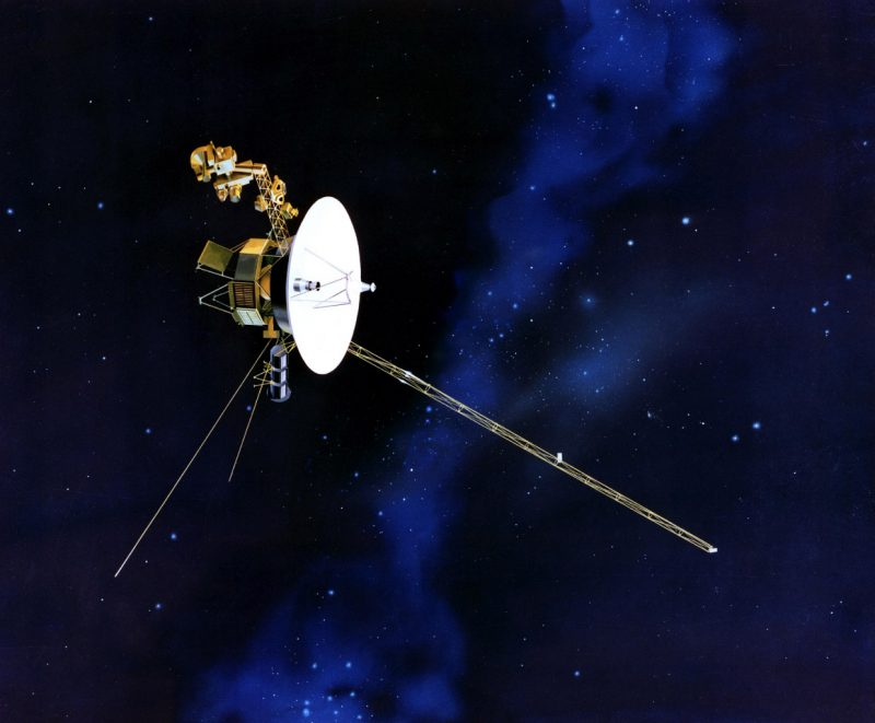Spacecraft with large dish antenna and long thin antennae.