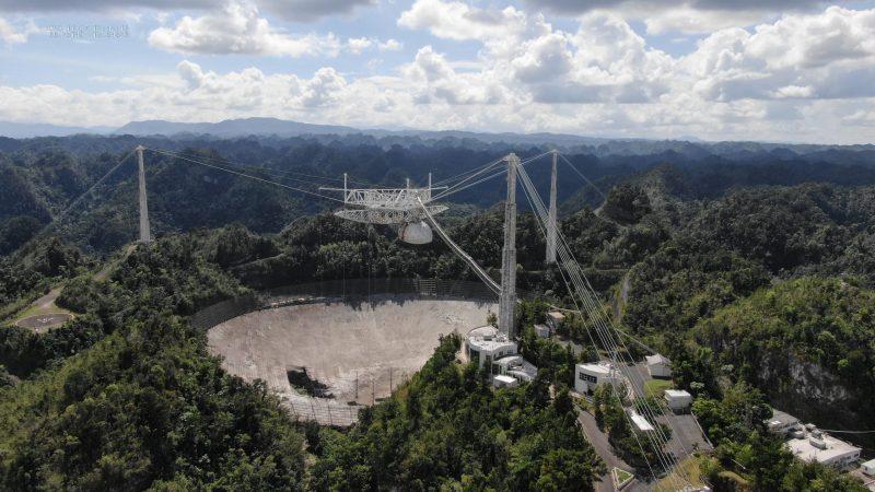 Arecibo radio telescope, a large dish-type telescope built into a natural depression in the landscape in Puerto Rico.