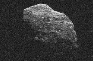 Gray, irregular chunk of rock against a black background.