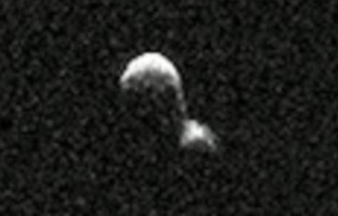 Black-and-white radar image of 2 roundish objects stuck together.