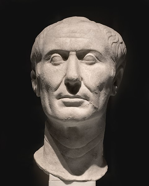 Head of short-haired man carved of white marble.