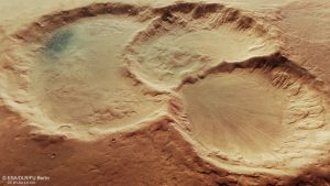 Three overlapping craters with worn edges.