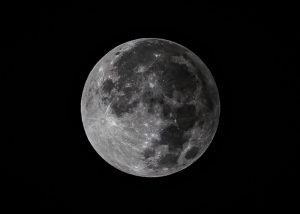 Full moon in penumbral eclipse; there's a shading on one side of the moon.