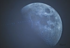 A blue-colored moon, with ISS tracking in front of it.
