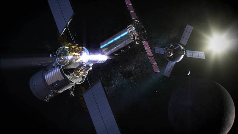 Two large spacecraft made of modules and solar power panels with Earth, moon and sun in background.