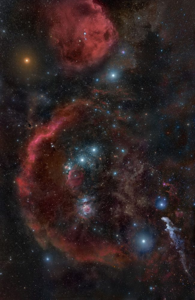 Stars of Orian surrounded with wispy red clouds.