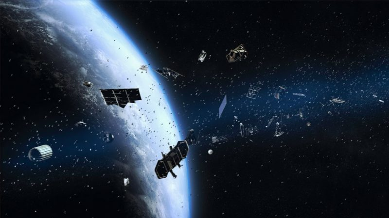 Satellites, dust, and other pieces of debris are seen floating in Earth's orbit.