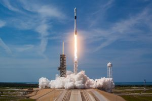 The SpaceX Falcon 9 rocket is seen launching into the sky from Pad 39A.