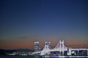 Jupiter and Saturn over South Korea's Diamond Bridge.