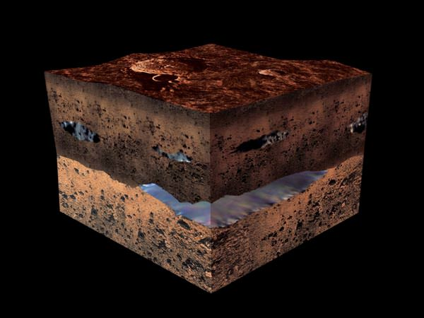 Mottled and layered cube with blue areas among the layers, on black background.