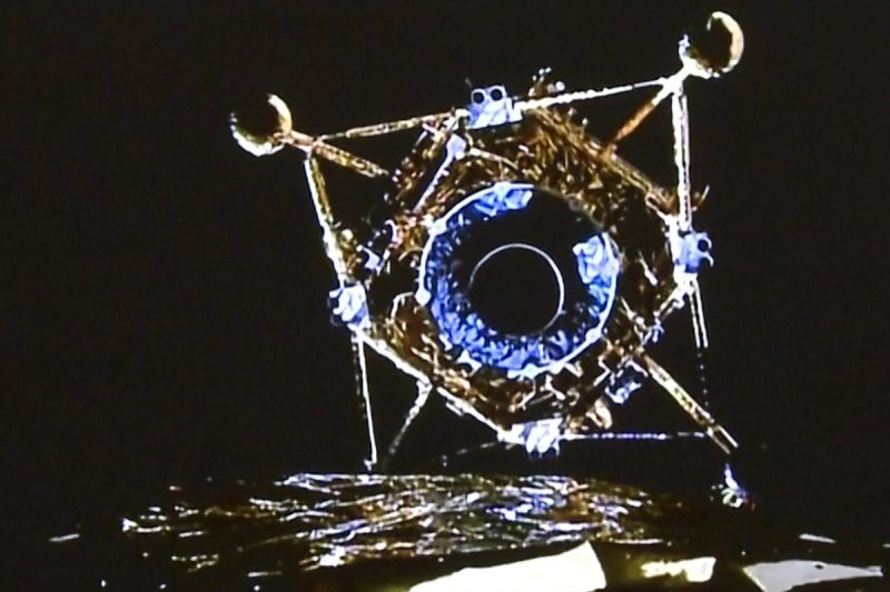 A fragile-looking, foil-covered lunar landing vehicle with four legs, viewed from orbiter.