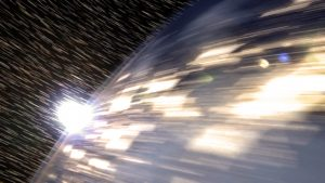Earth appearing to zoom along in orbit.