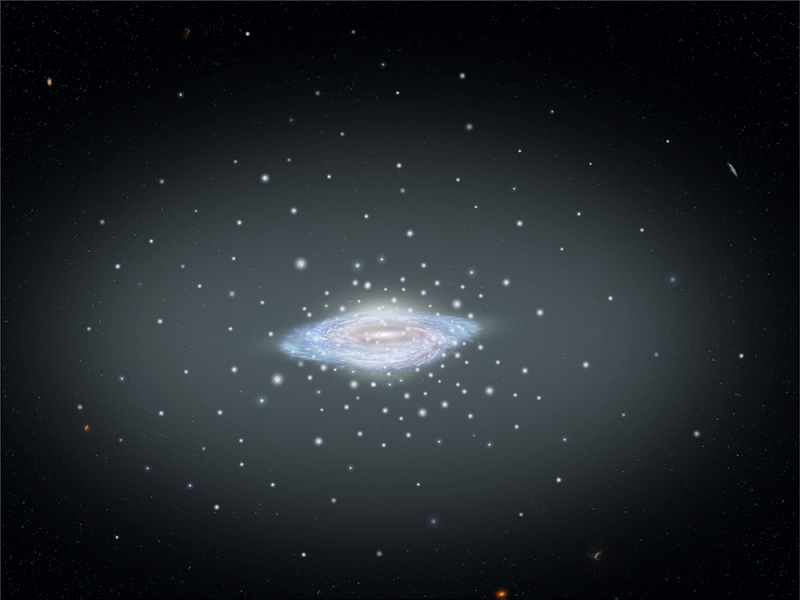Disk-shaped blob with many smaller bright dots and big, fuzzy pale halo around it.