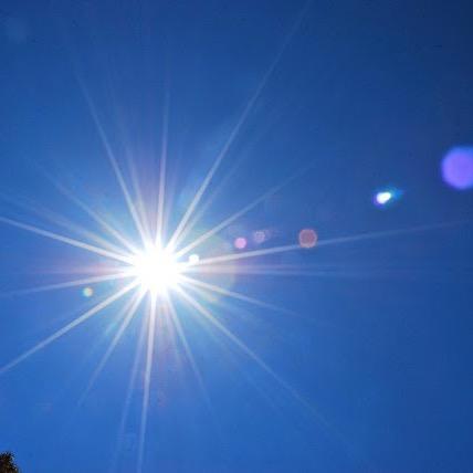 A bright sun in a blue sky.
