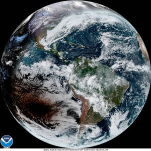 The whole globe of Earth, with a dark blot in one area: the moon's shadow.
