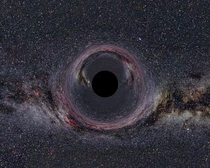 Black circle with thousands of stars in background.