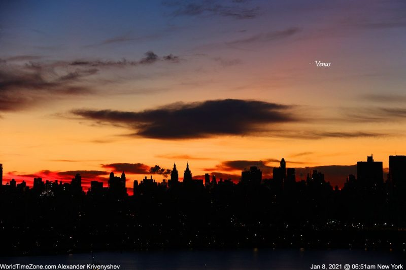 Labeled Venus above a skyscraper skyline in a bright yellow and pink sunrise.