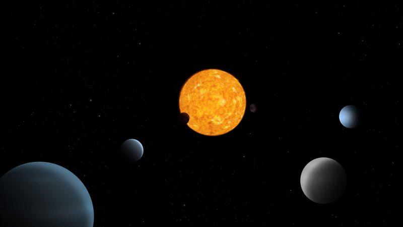 Planets near a reddish star.