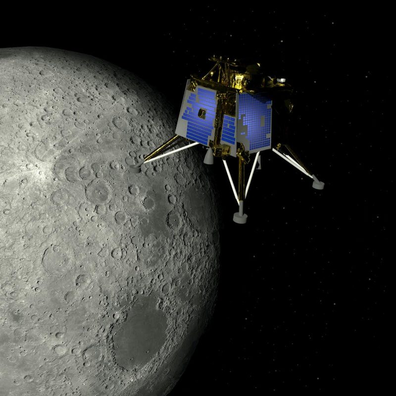 Box-like blue spacecraft with four legs in orbit around the moon.
