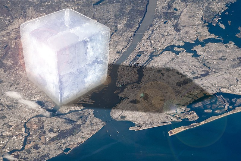 A huge cube of ice on the left side of an aerial view of New York City.