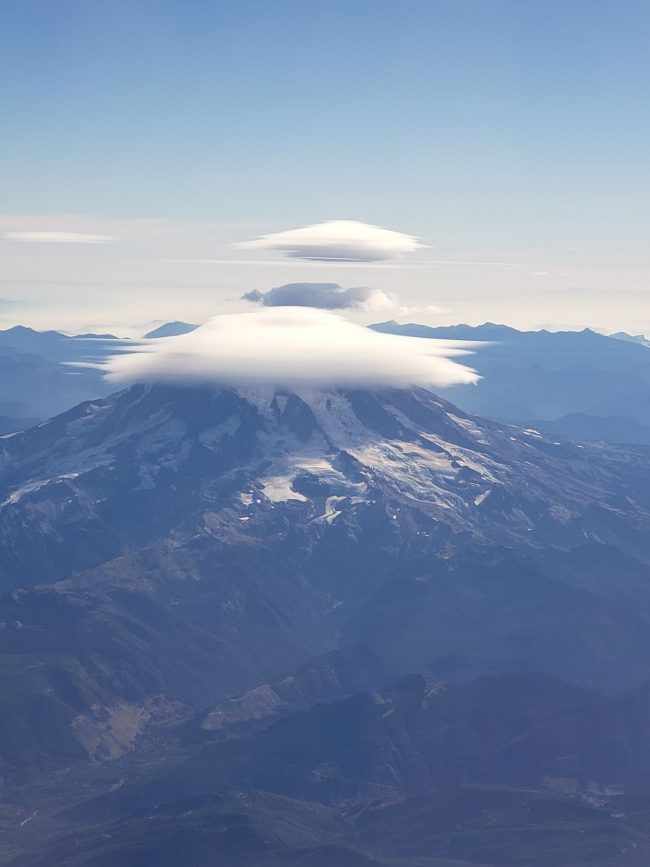 White cloud cap over Mount Rainier from above.