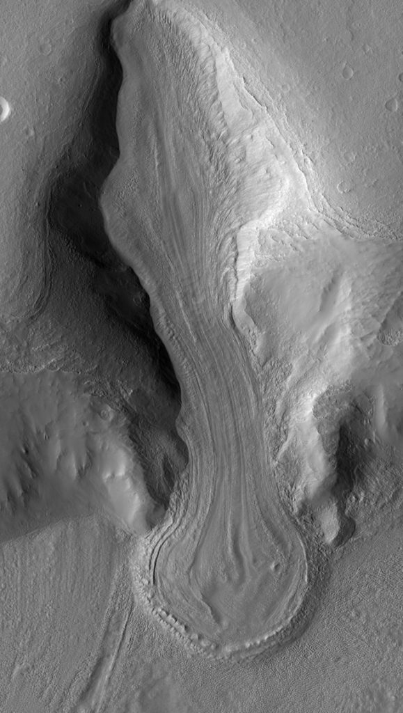 Long grooved tongue-shaped feature in gray-colored terrain.