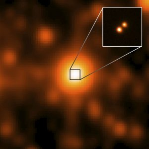 """A bright central blob, with an inset showing it """"split"""" into 2 objects."""