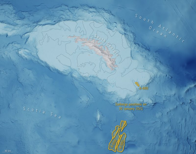 Island surrounded by ocean with depth indicated by color, and berg remnants outlined in yellow.
