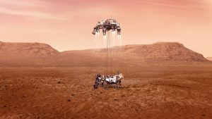 Wheeled machine touching the ground, dangling from a drone-like flyer with 4 rockets, in Mars landscape.