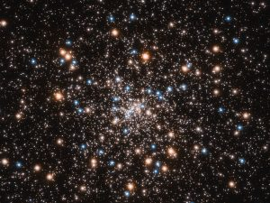Sphere of hundreds of stars clustered around a center point in a dense star field.