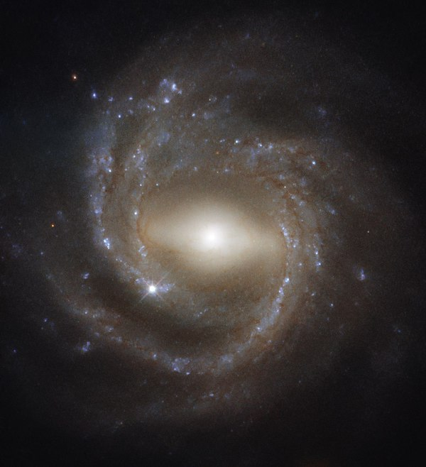 Horizontally stretched out glowing bulge - like a bar - with spiral arms around it.