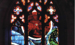 Colored circles in a stained glass window.