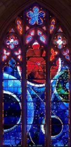 Red and blue orbs in stained glass.